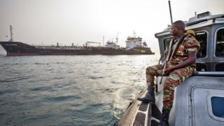sports An anti-piracy team watches over a cargo ship off the coast of West Africa.