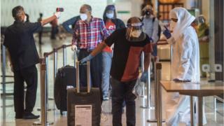 Passengers arrive at Chhatrapati Shivaji Maharaj International Airport.