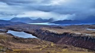 Looking over Loch ma Mna towards Skye from the summit of Dun Caan