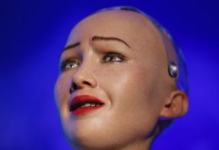 Humanoid robot Sophia delivers her speech during a conference.