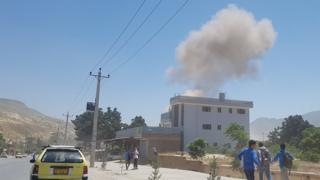 A plume of smoke rises from a building in northern Afghanistan during a Taliban attack