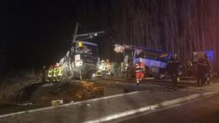Rescue workers are seen on the site of collision between train and school bus in Millas, France December 14, 2017