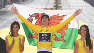 Geraint Thomas hold Welsh flag on Tour de France winner's podium in Paris