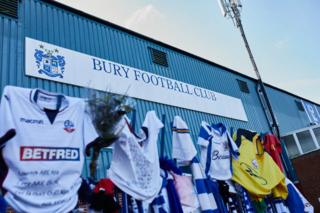 Scarves and jerseys outside Gigg Lane