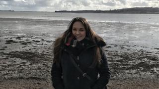 Lydia Vowden on a beach