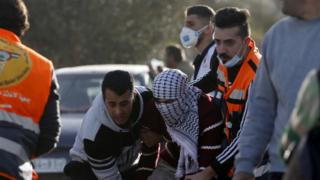 Palestinians evacuate a wounded protester during clashes with Israeli forces near Beita, in the occupied West Bank (11 March 2020)