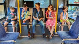 Adrian Crook's children, ages 5-11, taking the bus
