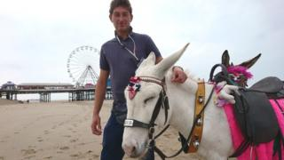 Jake Radford and donkey Charlie on Blackpool beach
