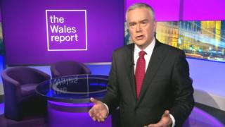 Huw Edwards presenting The Wales Report