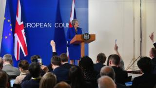 British Prime Minister Theresa May speaks at a news conference at the European Union Council headquarters