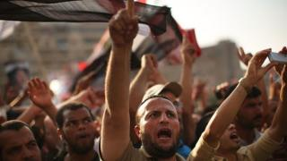 Pro Mohamed Morsi supporters rally near where over 50 were purported to have been killed by members of the Egyptian military and police in early morning clashes on July 8, 2013 in Cairo, Egypt.