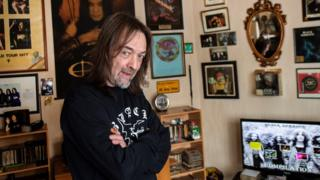 Stephen Knowles in his living room devoted to Black Sabbath