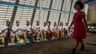 "A model presents a creation as inmates crochet clothing as part of ""Ponto Firme"" project in the Adriano Marrey maximum security penitentiary in Guarulhos, Brazil on May 22, 2019"