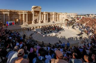 Russian conductor Valery Gergiev leading a concert at the Palmyra ruins in Syria.
