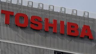 A Toshiba company logo appears on a building in Tokyo