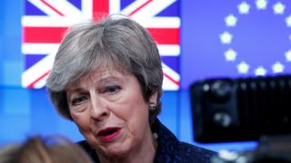 Theresa May speaks to the press at the European Council headquarters in Brussels on Thursday