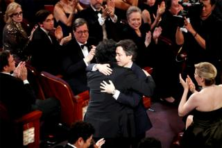 in_pictures Director Bong Joon-ho receives a hug from Noah Baumbach