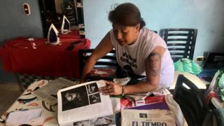 Beatriz Méndez with newspaper clippings