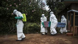 Health workers carry out the corpse of a unconfirmed Ebola case, from the ebola treatment centre (ETC) in Mangina, DRC