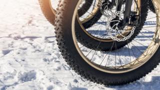 Bicycle wheel on snow