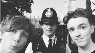 PC Keith Palmer stationed in front of the Houses of Parliament with Will, left, and Tyler, right.