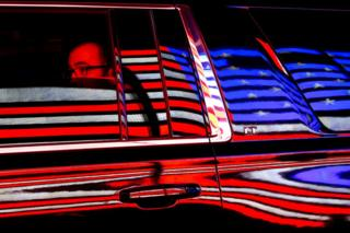 in_pictures The US flag is reflected in a taxi window during the 100th New York Veterans' Day Parade.