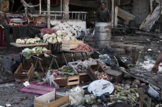 A fruit and vegetable stall in Eastern Ghouta following an air strike