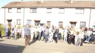 People outside house in Pathhead