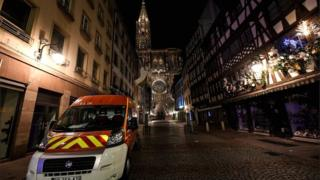 Rescue vehicles are parked near the Christmas market near the site of the deadly shooting in Strasbourg on 12 December 2018