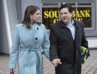 Jo Swinson and husband Duncan Hames leave the Southbank centre in London,