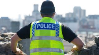 A police officer looking out over Cardiff