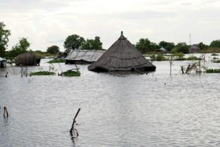 A structure is seen covered by water after heavy rains and floods forced hundreds of thousands of people to leave their homes, in the town of Pibor, Boma state