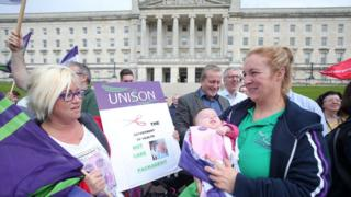 Members of the Unison trade union protest at Stormont against proposed health service cuts