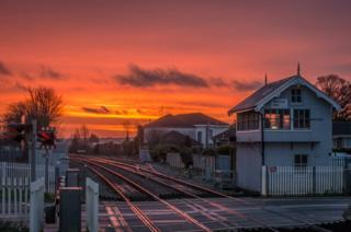 Sunrise at a train station