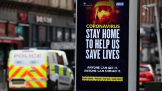Police patrol the streets of Glasgow as the UK continues in lockdown to help curb the spread of the coronavirus.