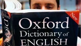 Pesin wey dey read Oxford dictionary