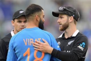 "New Zealand""s captain Kane Williamson (R) greets India""s captain Virat Kohli at the end of play during the 2019 Cricket World Cup first semi-final between New Zealand and India at Old Trafford in Manchester, northwest England, on July 10, 2019. -"
