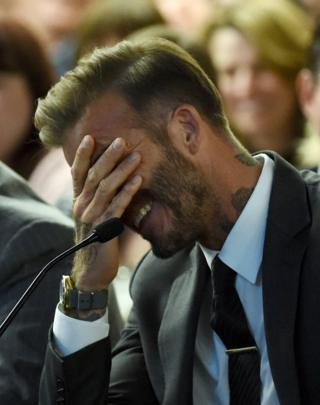 Former soccer player David Beckham laughs during a Southern Nevada Tourism Infrastructure Committee meeting with Oakland Raiders owner Mark Davis (not pictured) at UNLV on April 28, 2016 in Las Vegas, Nevada.