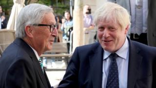 UK Prime Minister Boris Johnson shakes hands with European Commission President Jean-Claude Juncker