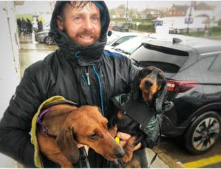 Kes Vadika with his two dogs