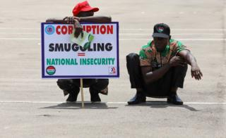 Members of the Nigeria Labour Congress (NLC) hold a placard at Eagle Square during a May Day rally in Abuja, Nigeria May 1, 2017.