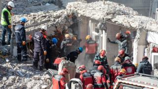 Rescue workers work at the scene of a collapsed building on 26 January 2020 in Elazig, Turkey.