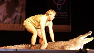 Steve Irwin with a crocodile on stage