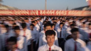 Students attend a mass rally on Kim Il-Sung sqaure in Pyongyang on September 23, 2017. Tens of thousands of Pyongyang residents were gathered in the capital's Kim Il-Sung sqaure to laud leader Kim Jong-Un's denounciation of US President Donald Trump.