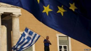 Person waving Greek flag