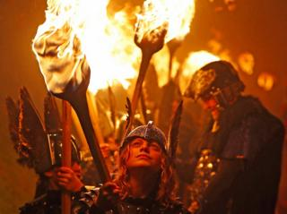 Members of the Junior Jarl Squad carry flaming torches