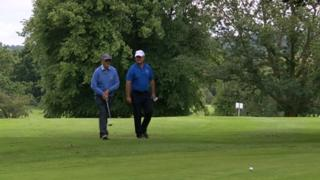 Graham Sutherland and Mark Phillips playing golf