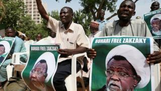 Protesters hold banners calling for the release of Sheikh Ibrahim Zakzaky