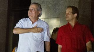 Jose Dirceu (left), former Chief of Staff of President Luiz Inacio Lula da Silva accused in the Mensalao scandal, arrives at the headquarters of the Federal Police in Sao Paulo, Brazil on 15 November, 2013.