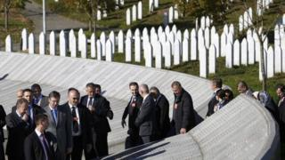 Serbia's Prime Minister Aleksandar Vucic (fourth left) is accompanied by Bakir Izetbegovic (left), member of Tripartite Bosnian Presidency, as they walk at the Memorial Center Potocari, near Srebrenica, Bosnia and Herzegovina, 11 November 2015